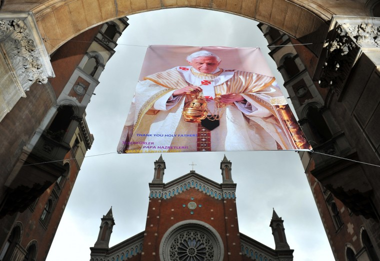 "A poster showing Pope Benedict XVI portrait is hanged in front of St. Anthony of Padua Church reading ""Thank you holy father"" on February 27, 2013 in Istanbul. Pope Benedict XVI will hold the last audience of his pontificate in St Peter's Square on Wednesday on the eve of his historic resignation as leader of the world's 1.2 billion Catholics. (Bulent Kilic/Getty Images)"