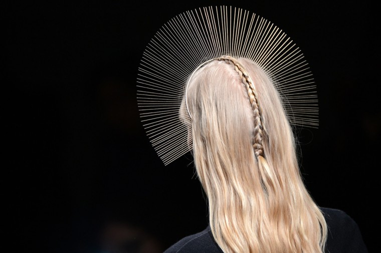 A model presents a creation by Nicolas Andreas Taralis during the Fall/Winter 2013-2014 ready-to-wear collection show. (Martin Bureau/Getty Images)