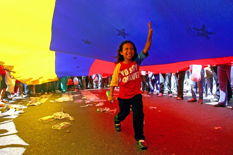 "A child, supporter of Venezuelan President Hugo Chavez and wearing a T-shirt reading ""I am Chavez"", takes part in a rally in Caracas to commemorate 24 years of the Patriotic Rebellion of 1989. The ""Caracazo"" of 1989 was a wave of protests against the neoliberal reforms of imposed by the government of Carlos Andres Perez, in which some 3000 people were killed. (Geraldo Caso/Getty Images)"