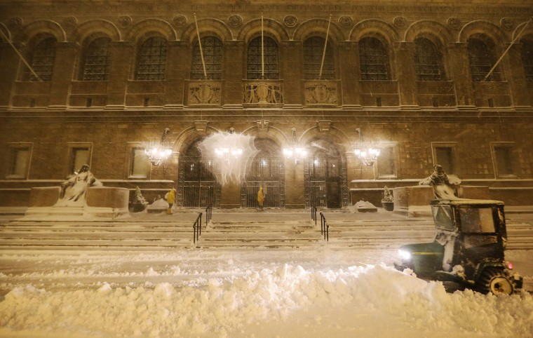 Snow is cleared in front of the Boston Public Library on February 8, 2013 in Boston. Massachusetts as well as other states from New York to Maine are hunkered down for a major blizzard with possible record amounts of snowfall in some areas. (Mario Tama/Getty Images)