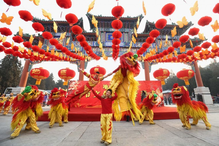 Chinese folk artists perform during the opening ceremony of the Spring Festival Temple Fair at the Temple of Earth park on February 9, 2013 in Beijing, China. The Chinese Lunar New Year of Snake also known as the Spring Festival, which is based on the Lunisolar Chinese calendar, is celebrated from the first day of the first month of the lunar year and ends with Lantern Festival on the Fifteenth day. (Feng Li/Getty Images)