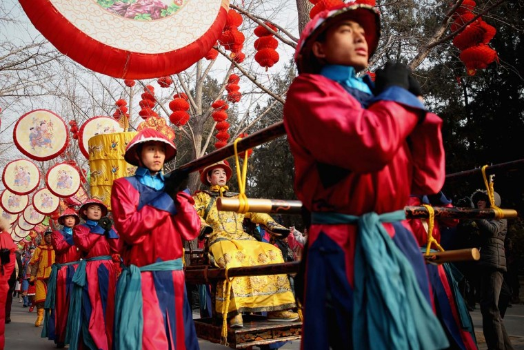 A performer (C) plays the role of the emperor during a re-enactment of an ancient ceremony of Qing Dynasty emperors praying for good harvest and fortune during the opening ceremony of the Spring Festival Temple Fair at the Temple of Earth park on February 9, 2013 in Beijing, China. The Chinese Lunar New Year of Snake also known as the Spring Festival, which is based on the Lunisolar Chinese calendar, is celebrated from the first day of the first month of the lunar year and ends with Lantern Festival on the Fifteenth day. (Feng Li/Getty Images)