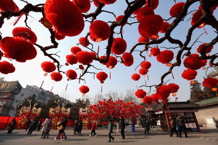 Visitors stroll near the trees decorated with red lanterns ahead of Chinese New Year celebrations during the opening ceremony of the Spring Festival Temple Fair at the Temple of Earth park on February 9, 2013 in Beijing, China. The Chinese Lunar New Year of Snake also known as the Spring Festival, which is based on the Lunisolar Chinese calendar, is celebrated from the first day of the first month of the lunar year and ends with Lantern Festival on the Fifteenth day. (Feng Li/Getty Images)