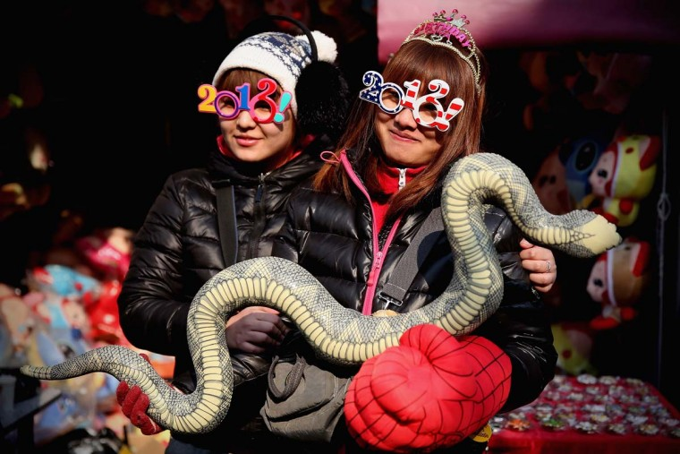 Vendors show the toy of snake at the Spring Festival Temple Fair for celebrating Chinese Lunar New Year of Snake at the Temple of Earth park on February 9, 2013 in Beijing, China. The Chinese Lunar New Year of Snake also known as the Spring Festival, which is based on the Lunisolar Chinese calendar, is celebrated from the first day of the first month of the lunar year and ends with Lantern Festival on the Fifteenth day. (Feng Li/Getty Images)