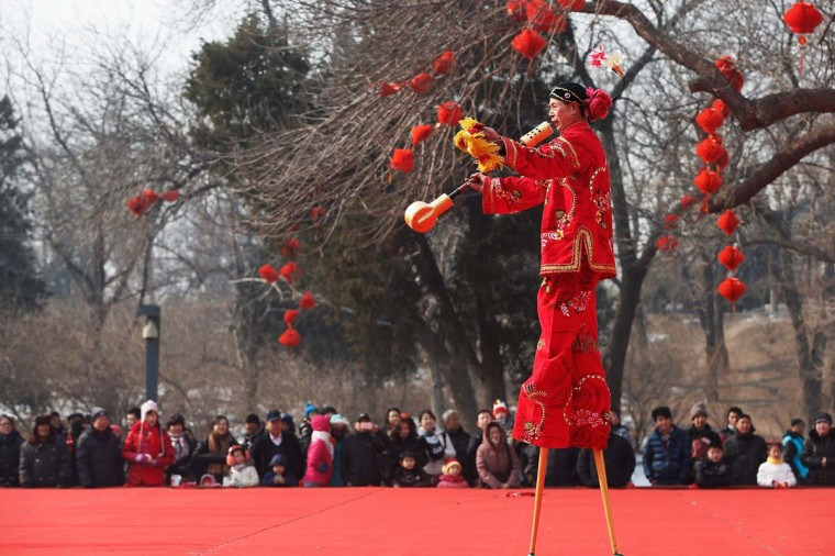 Chinese folk artists perform during the opening ceremony of the Spring Festival Temple Fair at Dragon Lake Park on February 9, 2013 in Beijing, China. The Chinese Lunar New Year of Snake also known as the Spring Festival, which is based on the Lunisolar Chinese calendar, is celebrated from the first day of the first month of the lunar year and ends with Lantern Festival on the Fifteenth day. (Lintao Zhang/Getty Images)