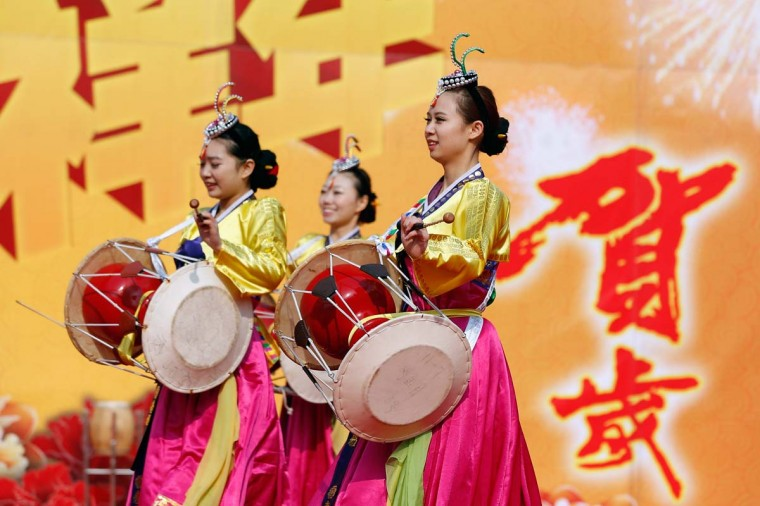 Chinese folk artists perform during the opening ceremony of the Spring Festival Temple Fair at Dragon Lake Park on February 9, 2013 in Beijing, China.The Chinese Lunar New Year of Snake also known as the Spring Festival, which is based on the Lunisolar Chinese calendar, is celebrated from the first day of the first month of the lunar year and ends with Lantern Festival on the Fifteenth day. (Lintao Zhang/Getty Images)