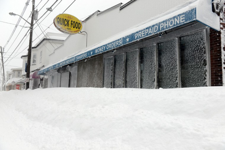 Stores along Shirley Street in Winthrop, Mass., are blocked by snow, February 9, 2013. The powerful storm has knocked out power to 650,000 and dumped more than two feet of snow in parts of New England. (Darren McCollester/Getty Images)