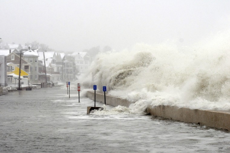 The ocean overflows the sea wall on Winthrop Shore Drive February 9, 2013 in Winthrop, Mass. An overnight blizzard left one to two feet of snow in areas, and coastal flooding is expected as the storm lingers into the day. (Darren McCollester/Getty Images)