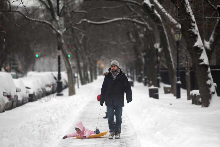 A man pulls a child on a sled in Prospect Park in Brooklyn the morning after a massive snow storm on February 9, 2013 in New York. (Spencer Platt/Getty Images)