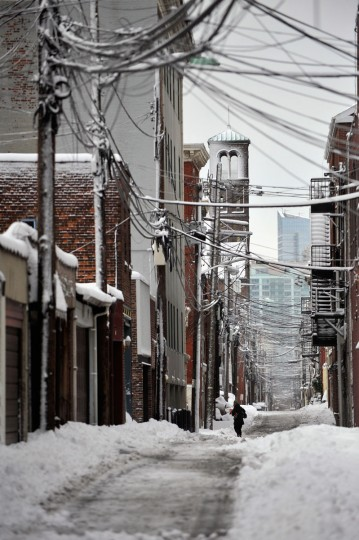 A person walks through the snow in an alley following a major winter storm on February 9, 2013 in Hoboken, N.J. Much of the Northeast received a foot or more of snow through Saturday morning with possible record-setting blizzard conditions expected. (Michael Bocchieri/Getty Images)