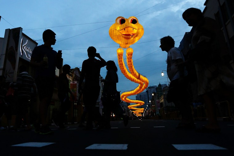 A snake-shaped sculpture made from about 850 yellow sky lanterns looms over a road in Chinatown on February 9, 2013 in Singapore. Thousands gathered to celebrate welcome the the Year of the Snake, (Suhaimi Abdullah/Getty Images)