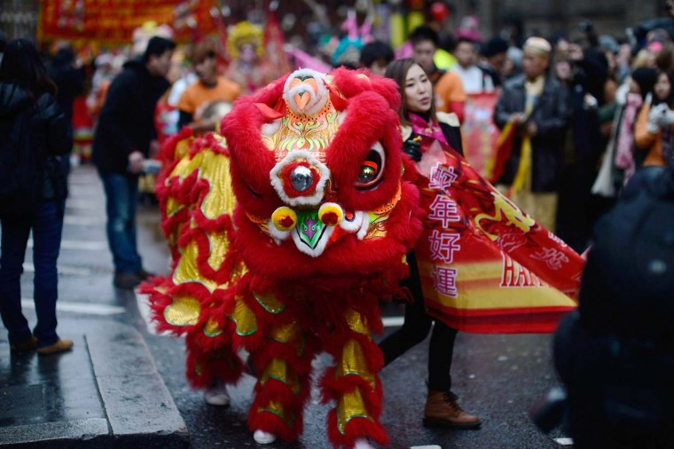 Traditional Lion Dancers lead the New Year paraded on February 10, 2013 in London, England. London's Chinese community celebrate the start of the Year of The Snake with traditional dancing, music and fireworks. (Bethany Clarke/Getty Images)