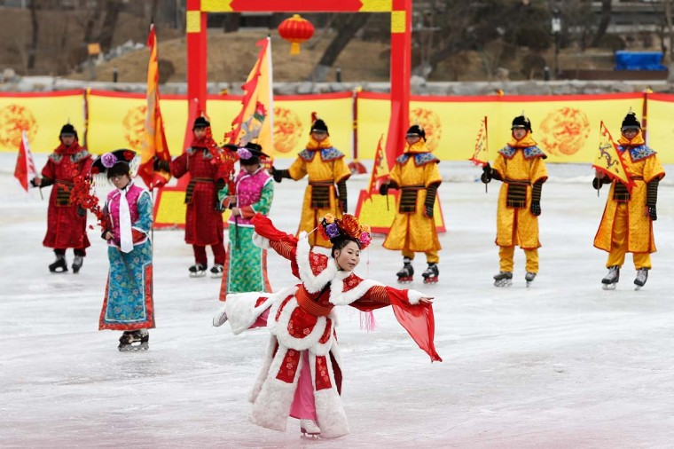 Chinese folk artists perform a play on ice during the Spring Festival Temple Fair on February 10, 2013 in Beijing, China. The Chinese Lunar New Year of the Snake also known as the Spring Festival, which is based on the Lunisolar Chinese calendar, is celebrated from the first day of the first month of the lunar year and ends with the Lantern Festival on the Fifteenth day. (Lintao Zhang/Getty Images)