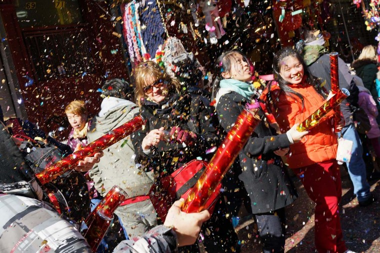 Members of the Chinese American community, tourists and other New Yorkers celebrate the the first day of the Lunar New Year, the Year of the Snake, in New York's Chinatown on February 10, 2013 in New York City. Celebrations are being held in Chinese communities around the world. The lighting of firecrackers are believed to ward off evil spirits and to bring the god of wealth into people's lives once New Year's Day arrives. (Spencer Platt/Getty Images)