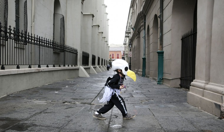 Brody Bell, 6, of New Orleans, runs across Pierre Antoine Alley dressed as a bald eagle skeleton for Mardi Gras Day February 12, 2013 in New Orleans, Louisiana. He was parading with his parents who are members of a Skeleton krewe. (Rusty Costanza/Getty Images)