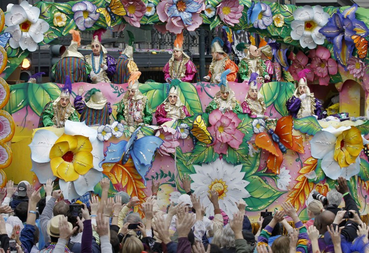 Revelers plead with out stretched arms for throws from riders in the Rex Parade in Canal Street on Mardi Gras Day. (Rusty Costanza/Getty Images)