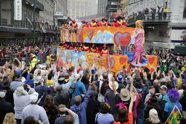A float in the Krewe of Zulu parade turns on to Canal Street to large crowds with out outstretched arms on Mardi Gras Day. (Rusty Costanza/Getty Images)