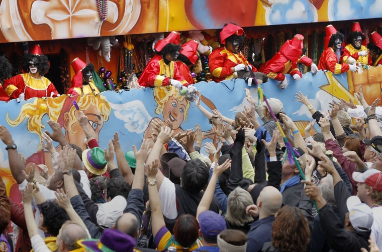 Riders in the Krewe of Zulu parade toss beads to the crowd below on Canal Street in New Orleans on Mardi Gras Day. (Rusty Costanza/Getty Images)