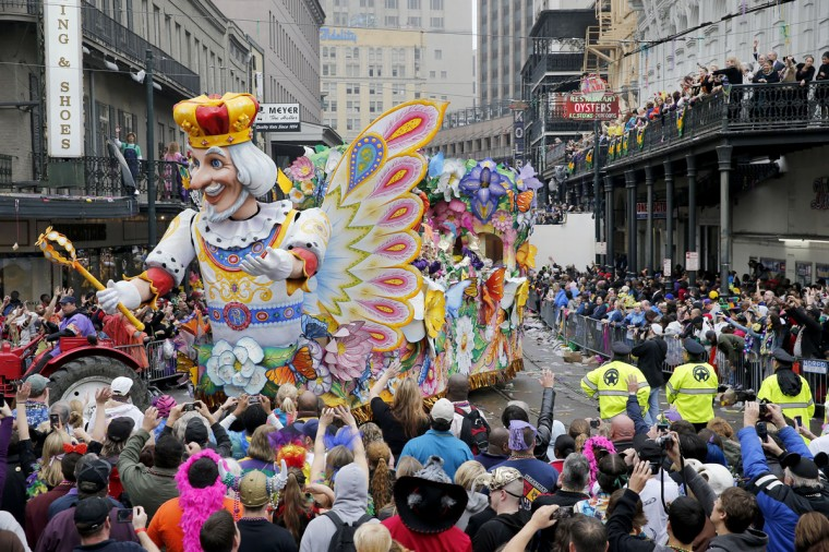 A float in the Rex parade turns on to Canal Street to large crowds with out outstretched arms on Mardi Gras Day. (Rusty Costanza/Getty Images)