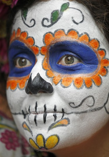 Kamil del Toro is dressed as a Day of the Dead sugar skull for Mardi Gras in the French Quarter. (Rusty Costanza/Getty Images)