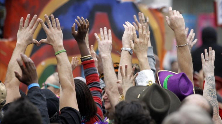 Revelers with out stretched hands plead for throws from riders in the Krewe of Zulu parade on Mardi Gras Day. (Rusty Costanza/Getty Images)