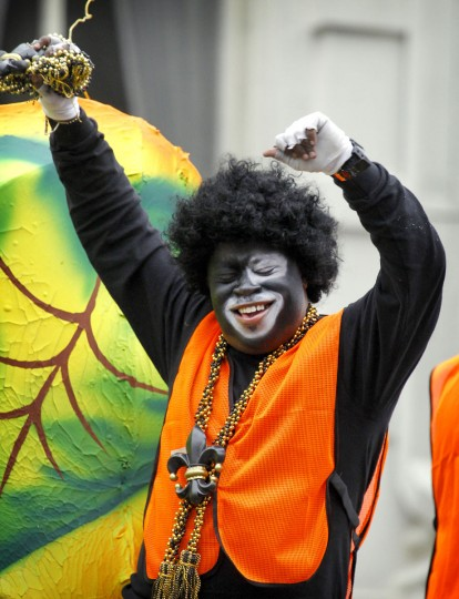A rider in the Krewe of Zulu parade dances as his float rolls down Canal Street in New Orleans on Mardi Gras Day. (Rusty Costanza/Getty Images)