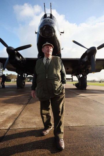 "Fred Panton, the owner of the Lincolnshire Aviation Heritage Centre, stands in front of the Lancaster bomber ""Just Jane"" which is being restored with the aim of getting it airworthy on February 14, 2013. The plane, which last flew in 1971, would become one of only three airworthy Lancaster bombers in the world. Brothers Fred and Harold Panton, owners of the Lincolnshire Aviation Heritage Centre, are restoring the plane in memory of their sibling, Christopher Panton, who died aged 19 when his Lancaster was shot down in 1944. (Oli Scarff/Getty Images)"