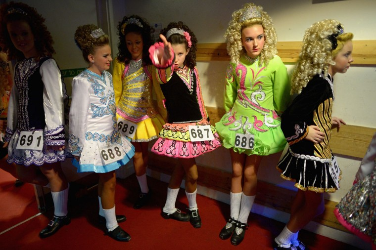 Dancers attend the 29th All Scotland Irish Dance Championship in Glasgow, Scotland. As many 2,000 competitors are taking part in one of the world's largest Irish dancing competitions with dancers coming from as far afield as North America, Russia, Australia and South Africa. (Jeff J Mitchell/Getty Images)