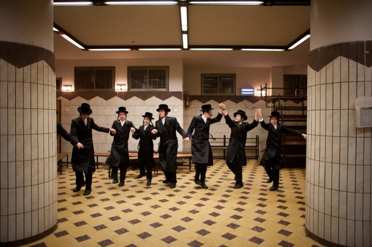 Ultra-Orthodox Jews celebrate Purim at a synagogue on February 23, 2013 in Bnei Brak, Israel.The carnival-like Purim holiday is celebrated with parades and costume parties to commemorate the deliverance of the Jewish people from a plot to exterminate them in the ancient Persian empire 2,500 years ago, as described in the Book of Esther. (Uriel Sinai/Getty Images)
