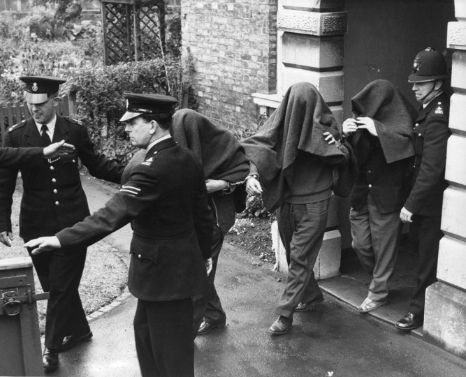 Three of the suspects arrested in connection with the 'Great Train Robbery', photographed leaving Linslade court with blankets over their heads. (Central Press/Getty Images)