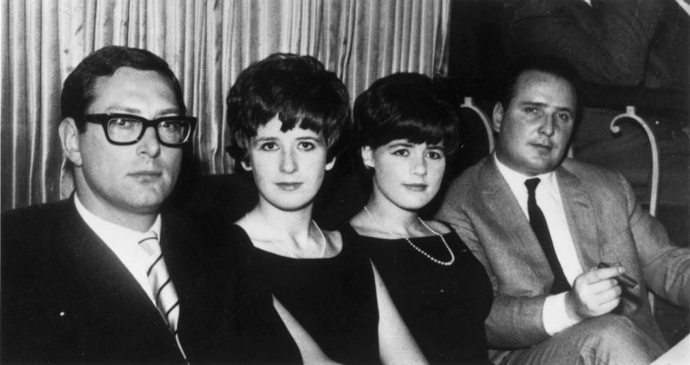 1963: English criminal Bruce Reynolds (left), a member of the gang which robbed a mail train of over two million pounds at Cheddington, Buckinghamshire, with (from left) his wife, Frances, Barbara Daly and John Daly. (J. Wilds/Keystone/Getty Images)