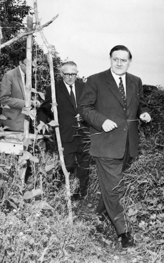 August 13, 1963: Detective Superintendent Gerald McArthur in the grounds of the suspects' hideout. Two and a half million pounds were stolen from a Royal Mail train and the crime became known as the Great Train Robbery. (Jim Gray/Keystone/Getty Images)