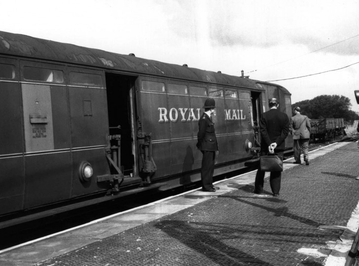 1963: Investigators examine the Royal Mail train involved in the Great Train Robbery. (Evening Standard/Getty Images)