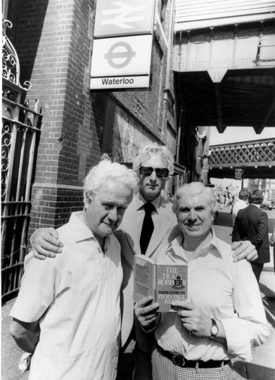 July 18, 1979: The Great Train Robbers, Roger Cordrey, Bruce Reynolds and Buster Edwards, at Waterloo Station, London, ready to go on a book promotion tour. (Central Press/Getty Images)