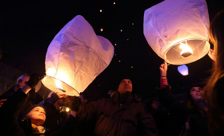Croatians gather in front of a museum to participate in an initiative by local artist Kresimir Tadija Kapulic (unseen) to release sky lanterns with people's Christmas and New Year's wishes, on December 20, 2012. (Stringer/AFP/Getty Images)
