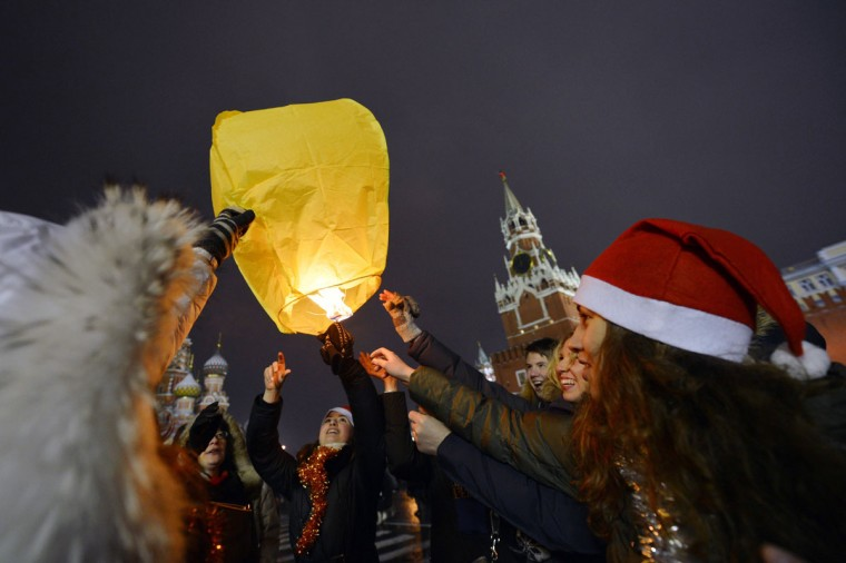 People release a lantern into the sky as they celebrate the New Year at the Red Square in Moscow, early on January 1, 2013. Tens of thousands of people gathered on the Red Square to celebrate the New Year at midnight. (Natalia Kolesnikova/AFP/Getty Images)