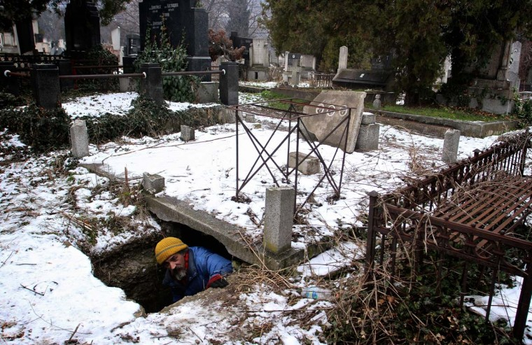 Bratislav Jovanovic leaves on January 10, 2013 a grave, he uses as a shelter during winter time at a cemetery in Nis, 200 kilometres south of Belgrade. Photo taken on January 10, 2013. (Sasa Djordjevic/AFP/Getty Images)
