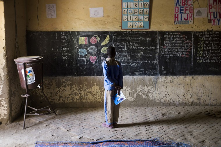 A Malian child stands in front of the black board of his school in Timbuktu, indicating the last day of class on March 22, 2012, as the school re-open today after 10 months of islamists ruling in Northern Mali. French-led troops worked today to secure the last Islamist stronghold in the north after a lightning offensive against the extremists. (Fred Dufour/AFP/Getty Images)