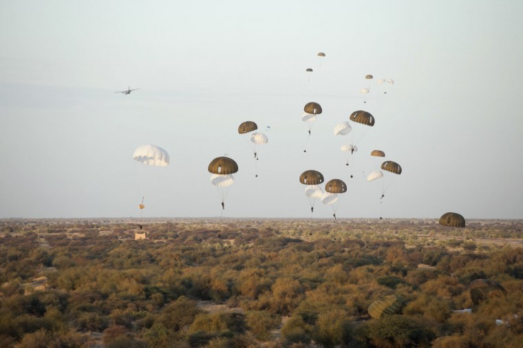 Ten paratroopers of the 17th Engineers Engineer Regiment paratrooper Montauban are dropped with materials from a C 130 and a C 160 aircrafts above the airport in Timbuktu, on January 29, 2013 as part of the French military operation codenamed Serval. (EMA-ECPAD/Arnaud Roine/AFP/Getty Images)