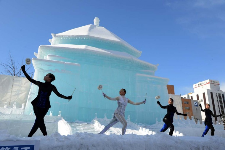 Taiwanese dancers perform in front of a large snow sculpture of Taipei's Chiang Kai-shek Memorial Hall at the opening of the annual snow festival in Sapporo, on Japan's northern island of Hokkaido on February 5, 2013. (Takashi Noguchi/AFP/Getty Images)