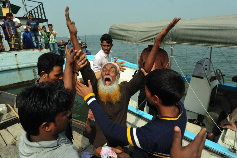 A Bangladeshi man mourns the loss of his relative after a ferry accident in Munshiganj. Scores of people were missing after a ferry carrying around 100 passengers sank following a collision on a river in Bangladesh Friday, the latest in a series of disasters blamed on lax safety standards. (STR/AFP/Getty Images)