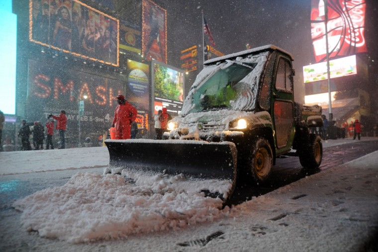Workers shovel snow in Times Square in New York on February 8, 2013 during a storm affecting the northeast U.S. (Mehdi Taamallah/AFP/Getty Images)
