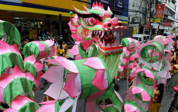Performers take part in a dragon dance on the eve of the Chinese Lunar New Year of the Snake, in China town in Manila on February 9, 2013. The Dragon Dance is usually performed during the Chinese New Year to bring in good luck and prosperity as billions of Chinese world wide celebrate Lunar New Year of the Snake on February 10. (Jay Directo/AFP/Getty Images)