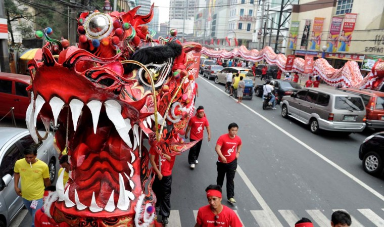 Performers take part in a dragon dance in the eve of the Chinese Lunar New Year of the Snake in China town in Manila on February 9, 2013. The Dragon Dance is usually performed during the Chinese New Year to bring in good luck and prosperity as billions of Chinese world wide celebrate Lunar New Year of the Snake. (Jay Directo/AFP/Getty Images)