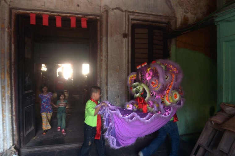 Young members of the Chinese community perform a lion dance as they celebrate the Chinese New Year in Kolkata on February 10, 2013. Chinese communities worldwide are welcoming the 'Year of the Snake'. (Dibyangshu Sarkar/AFP/Getty Images)