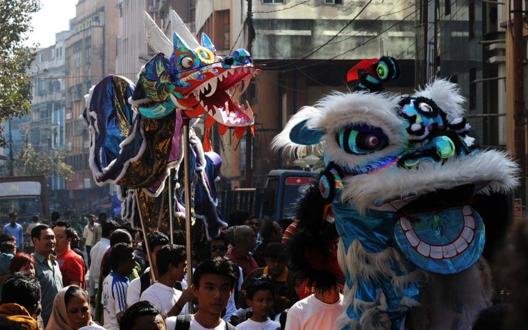 Members of the Chinese community perform a dragon (L) and lion dance as they celebrate the Chinese New Year in Kolkata on February 10, 2013. Chinese communities worldwide are welcoming the 'Year of the Snake'. (Dibyangshu Sarkar/AFP/Getty Images)