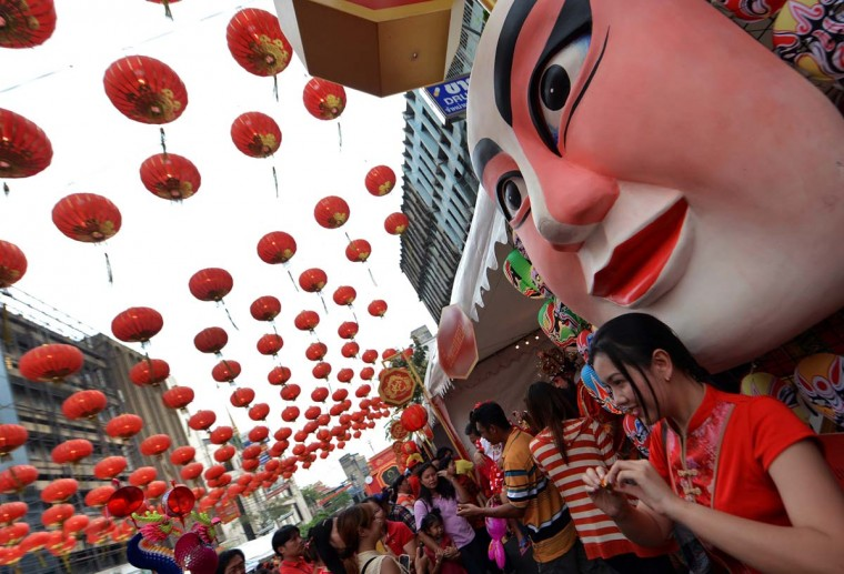 Thai-Chinese residents celebrate the Chinese New Year in Bangkok's China town on February 10, 2013. Chinese communities worldwide are welcoming the ' Year of the Snake '. (Pornchai Kittiwongsakul/AFP/Getty Images)
