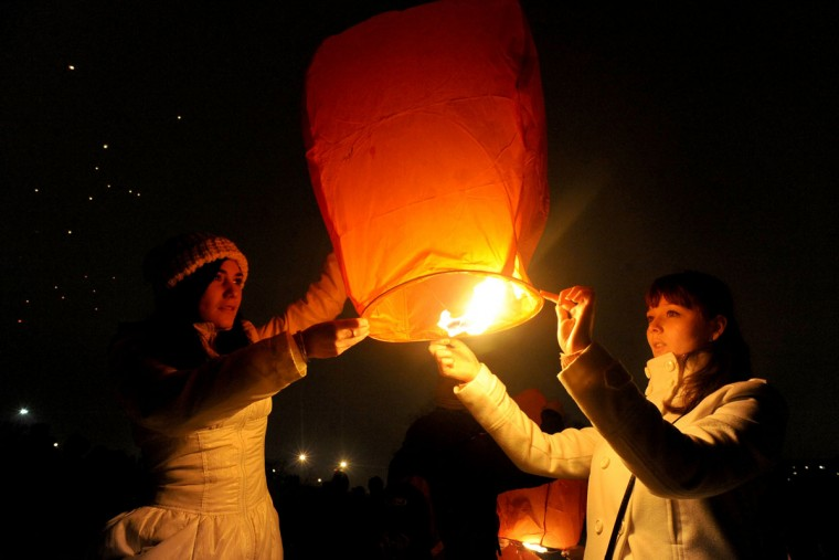 People light a sky lantern in St. Petersburg late on February 9, 2013 during celebrations marking the start of the Chinese lunar new year and year of the snake on February 10. (Olga Maltseva/AFP/Getty Images)