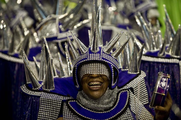 A reveler of Mocidade Alegre samba school performs during the second night of Carnival parades at the Sambadrome in Sao Paulo on February 10, 2013. (Nelson Almeida/AFP/Getty Images)