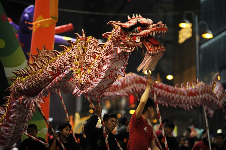 Participants take part in a dragon dance for the Chinese lunar new year parade through the streets of Hong Kong on February 10, 2013. Chinese lunar new year, celebrated by Chinese communities the world over, falls on February 10 with the beginning of the new moon. (Antony Dickson/AFP/Getty Images)